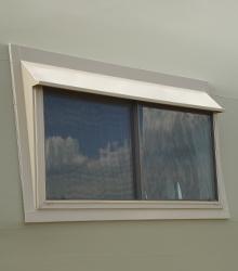 Sprung window with slider