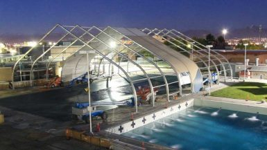 Contractors working on a Sprung Structure Sprung fabric structures tensile structure, enclosed pool facility for a Sports and Rec complex. Sprung tensile structur