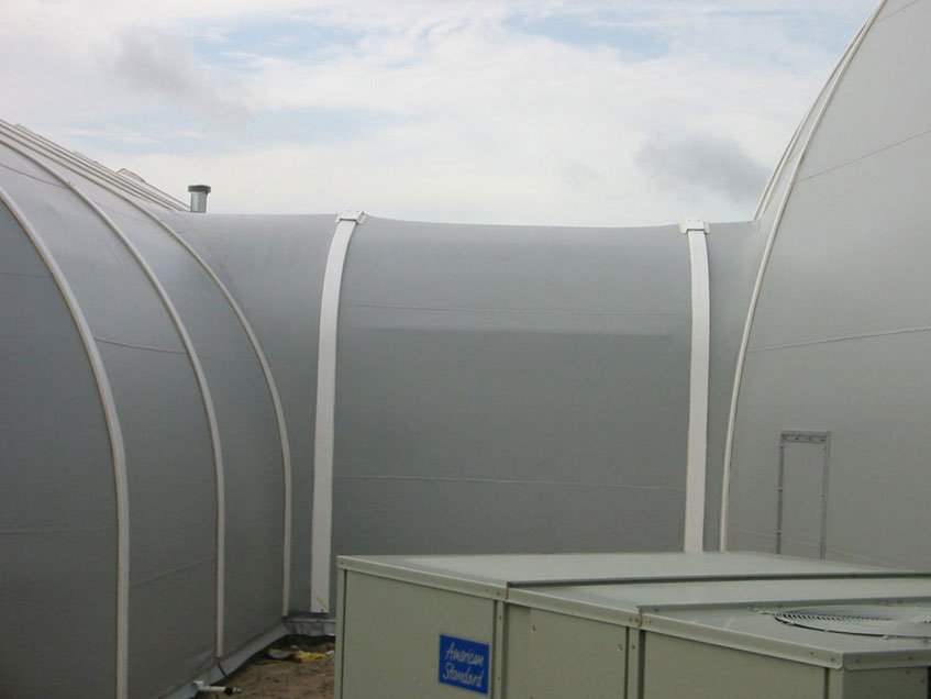 Sprung Connecting Corridors - tensile structure between two sprung buildings